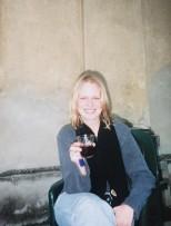Enjoying a glass of wine in the villa garden, 1999
