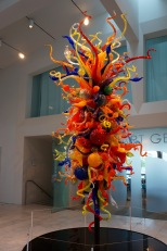 A Dale Chihuly glass sculpture welcomes guests.